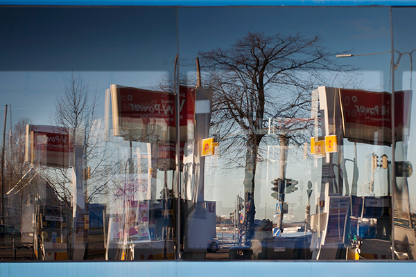 1_reflection_of_gas_station_on_a_bus_window